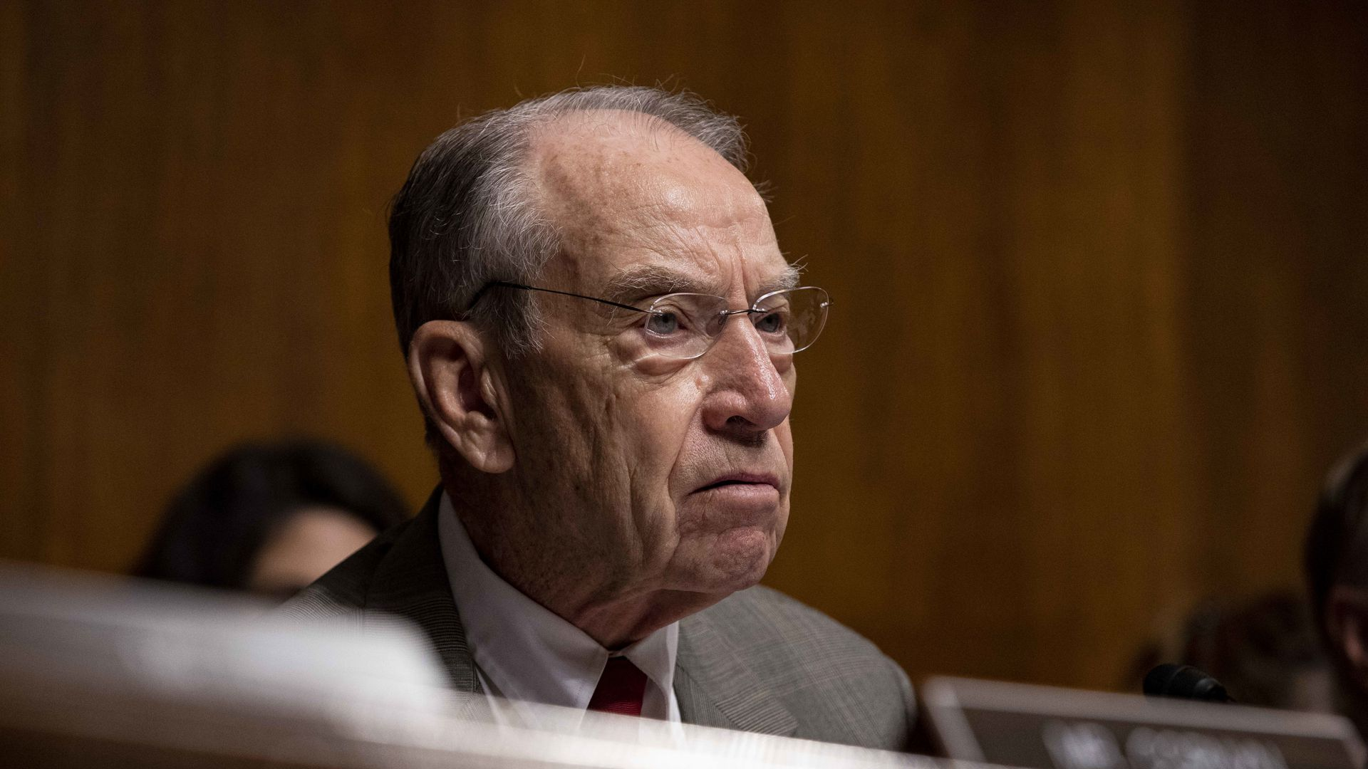 Senator Chuck Grassley sitting on a dais.