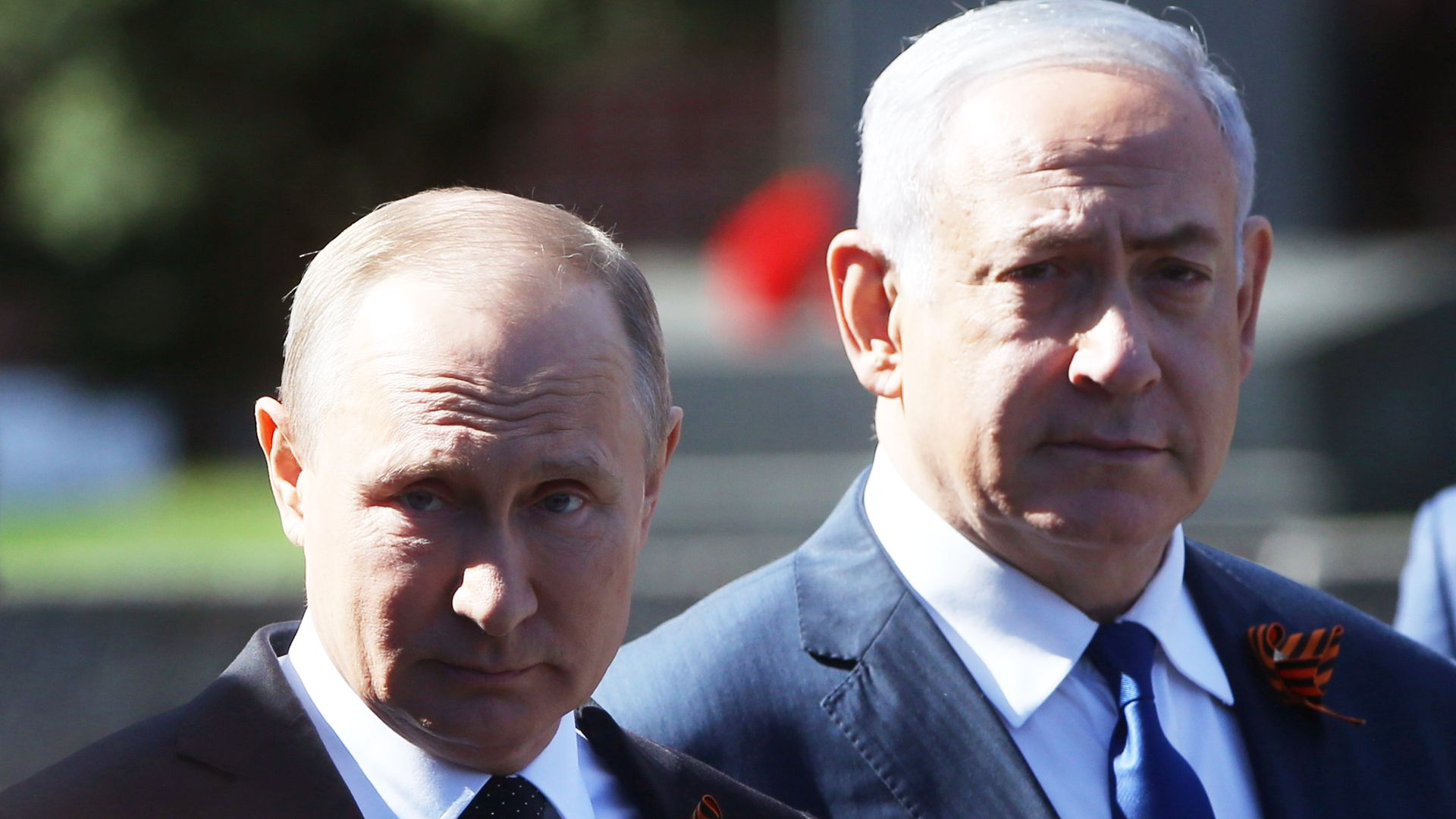 Vladimir Putin and Benjamin Netanyahu stand side by side