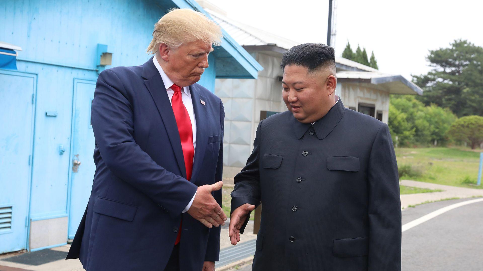Trump shaking Kim's hand in the demilitarized zone