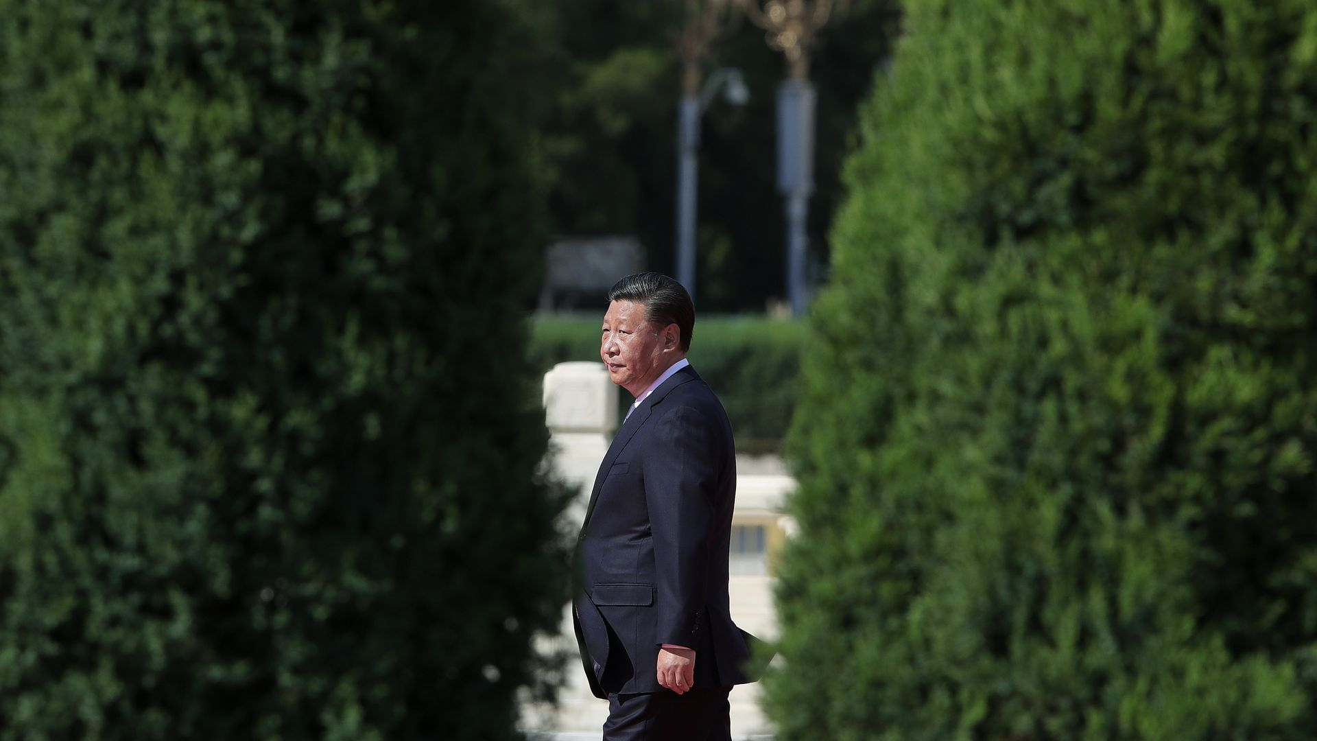 Photo of China President Xi Jinping walking on the grounds of a garden