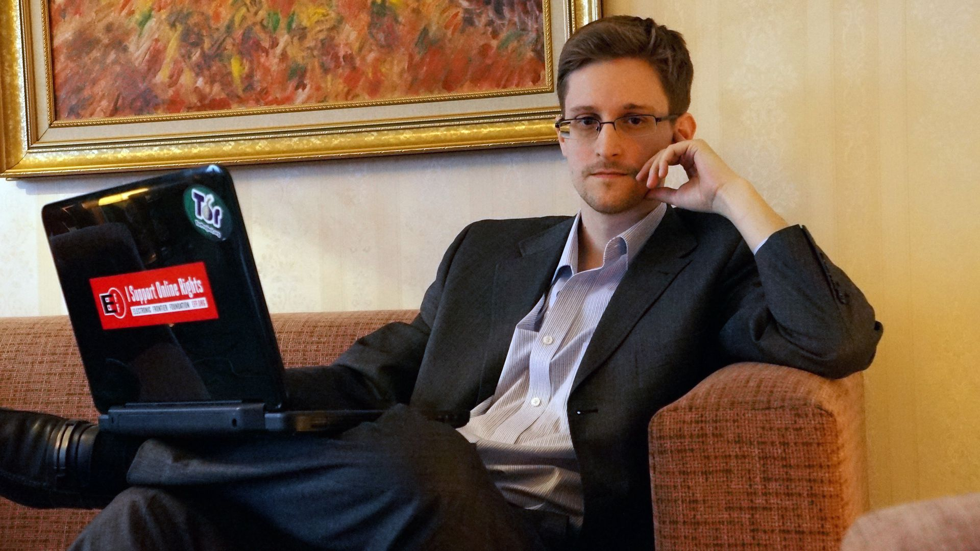 Edward Snowden posing for the camera.