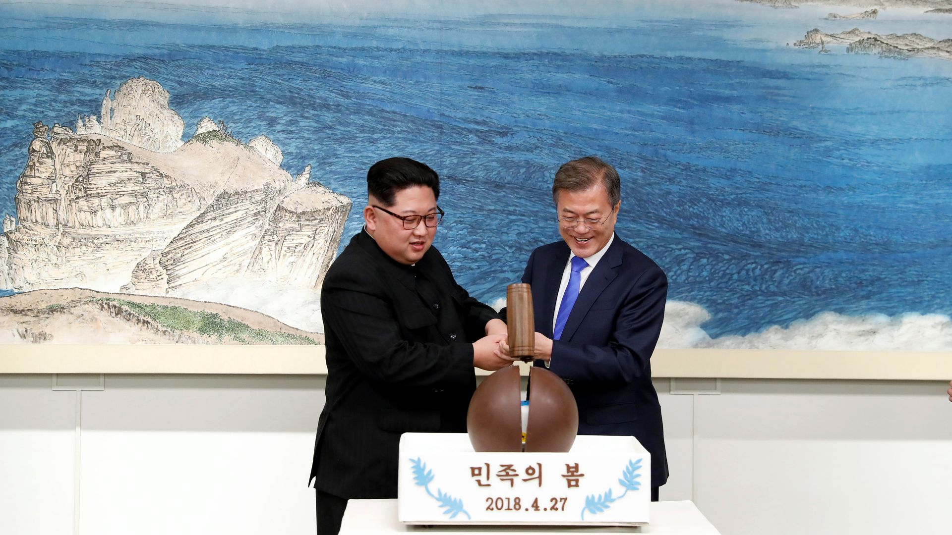 Kim Jong-un and Moon Jae-in take a mallet to a chocolate eggshell dessert