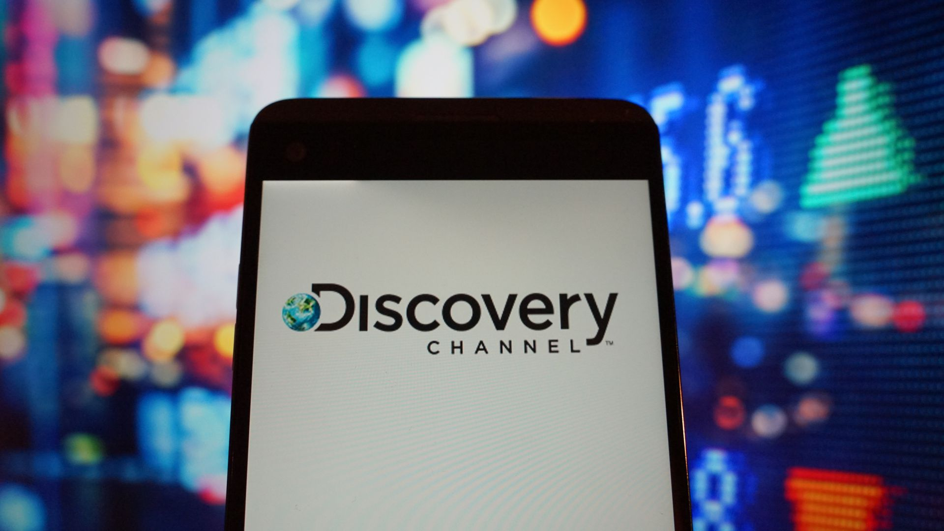 The logo of the Discovery Channel on a smartphone.