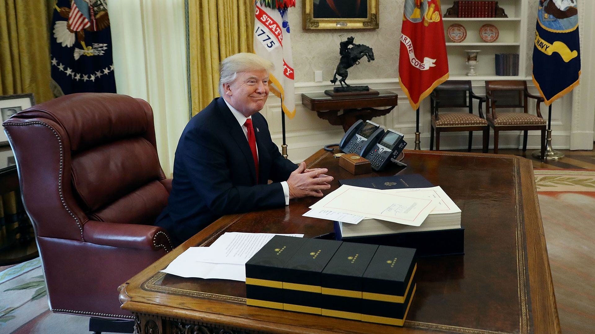 Trump smiles in the Oval Office