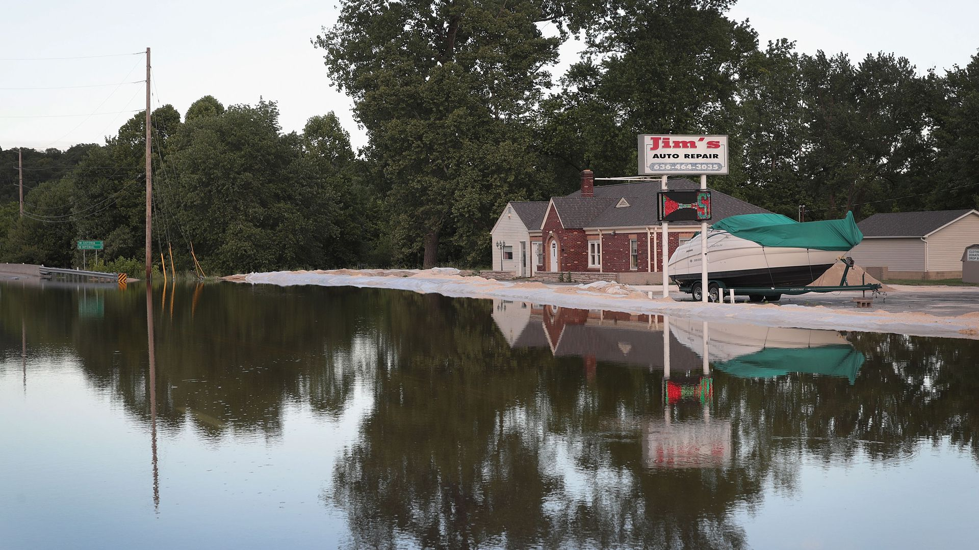 This image shows a small shop surrounded by floodwater.