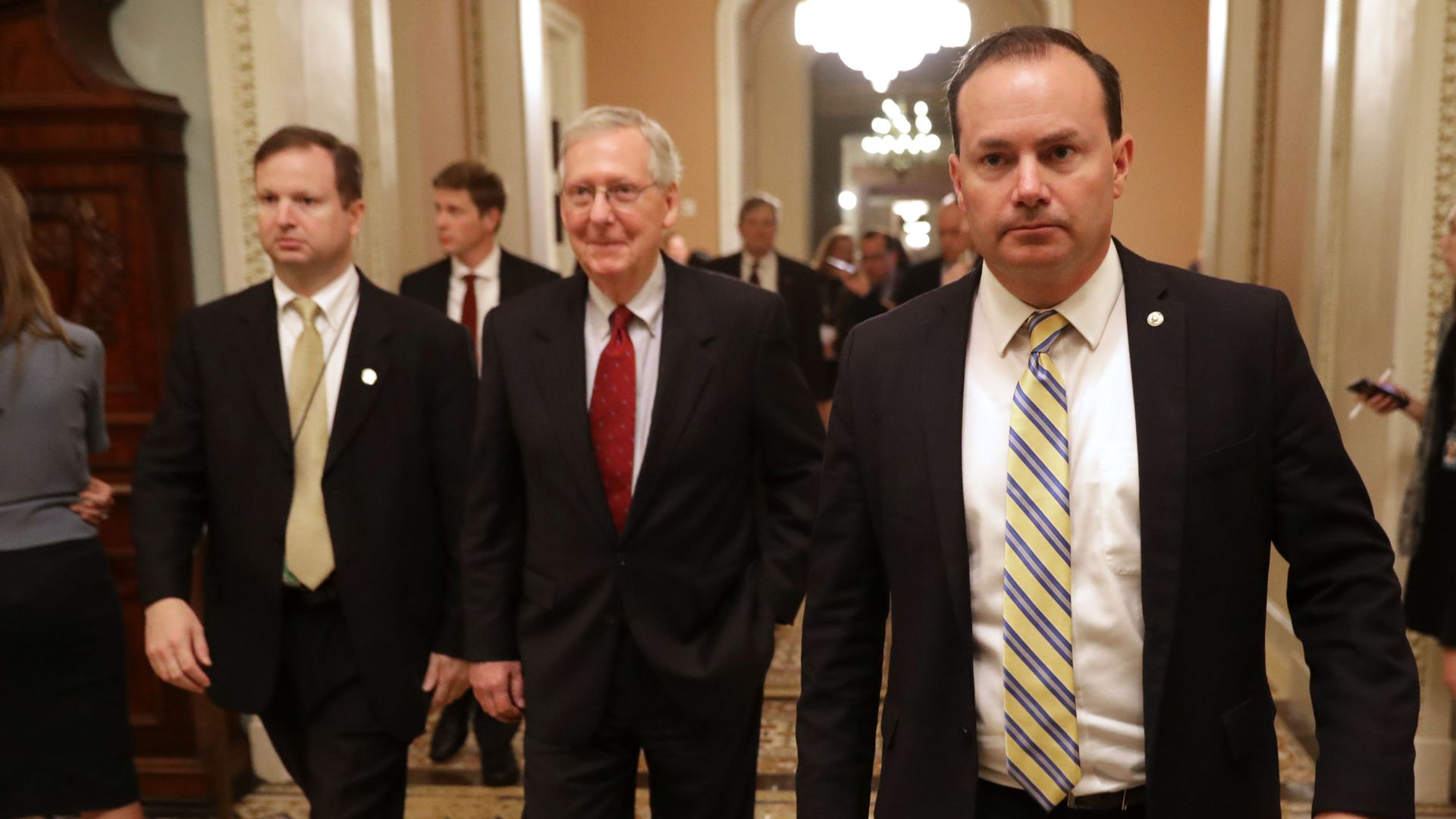 Mitch McConnell and Mike Lee walk.