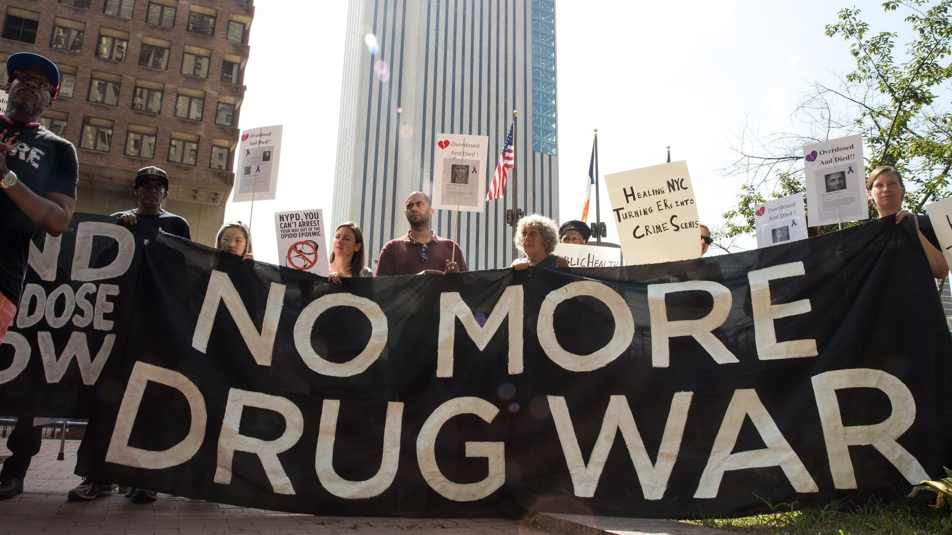 "Activists hold a sign that reads, ""No more drug war"""
