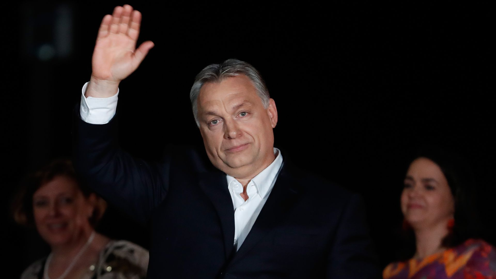 Viktor Orban waving to crowd of supporters