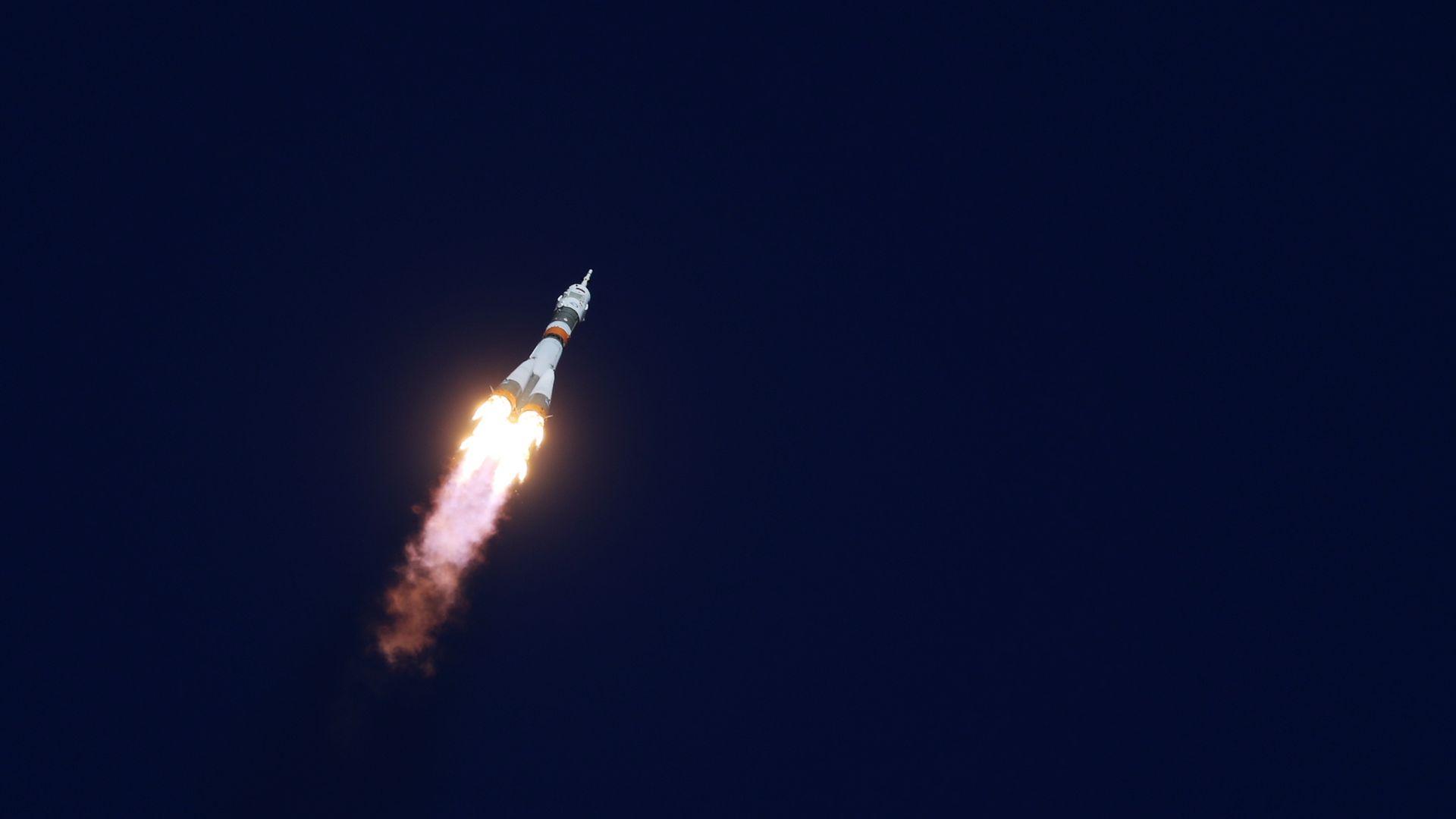 A rocket blasts off.