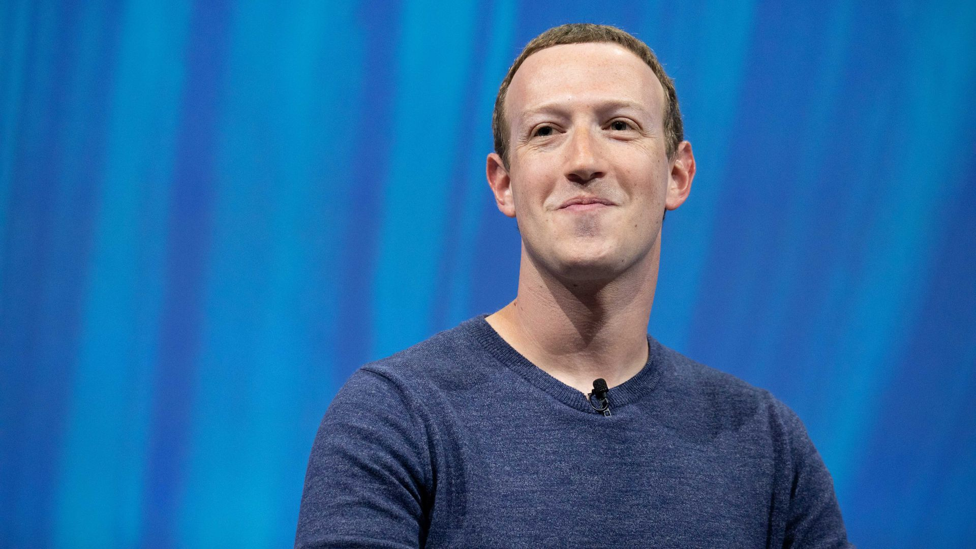 Facebook CEO Mark Zuckerberg with a half-smile on his face