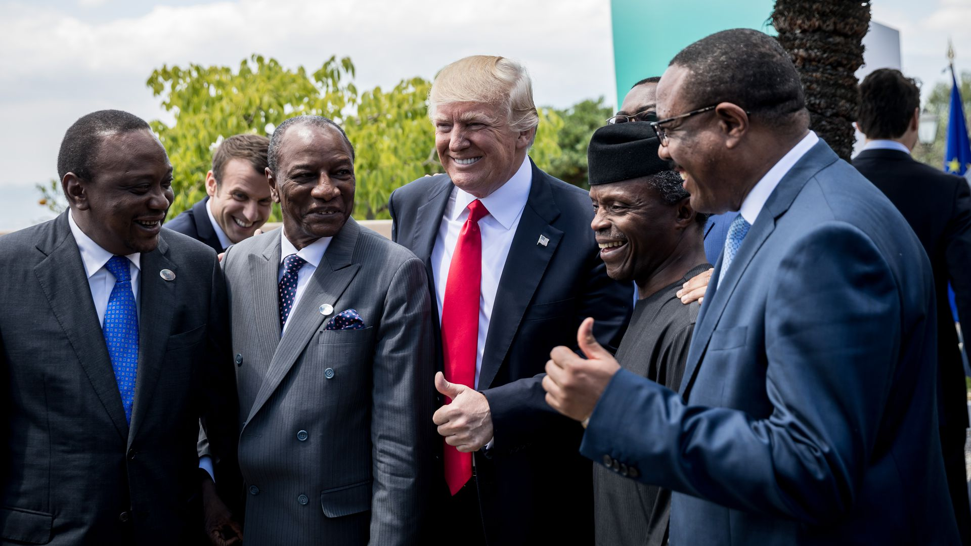 US President Donald Trump standing with Uhuru Kenyatt, Mahamadou Issoufou, Muhammadu Buhari and President of the African Development Bank.