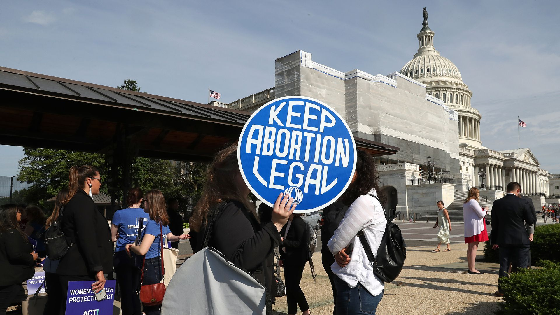 "A protestor holds a sign that reads ""keep abortion legal"" outside the Supreme Court."