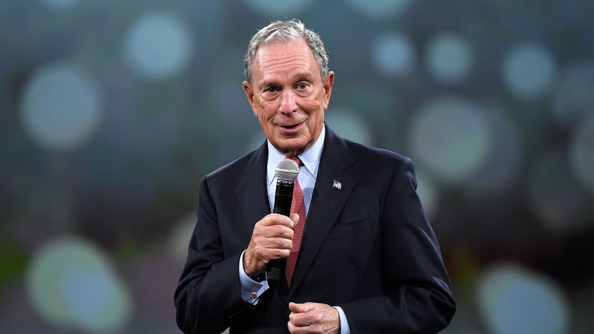 Michael Bloomberg with a mic in his hand