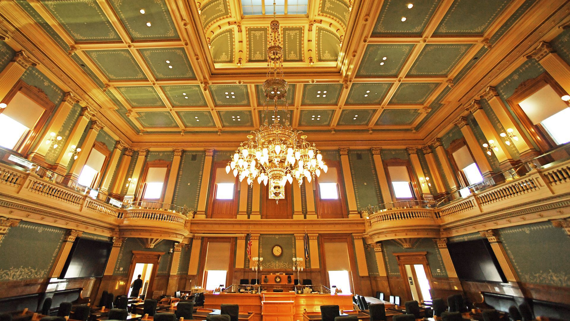 A grand room with a chandelier inside the Colorado state capitol building