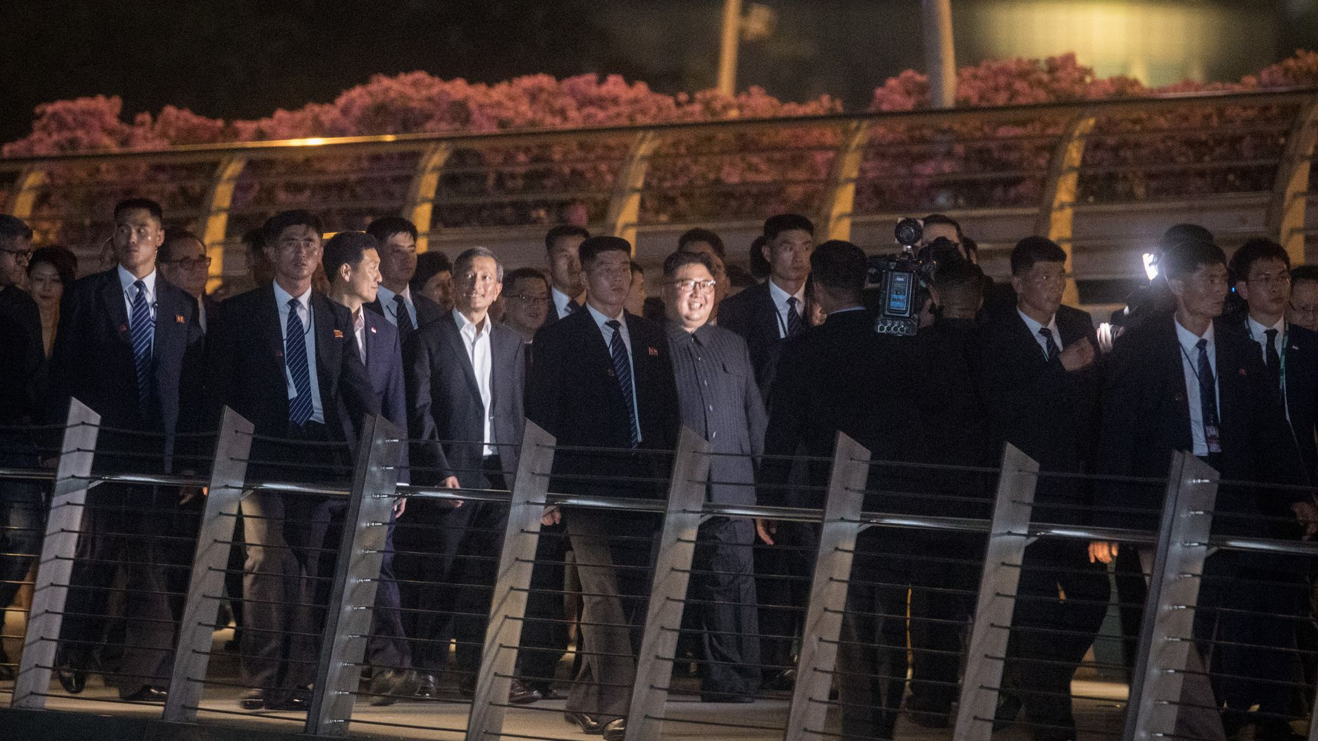 North Korean leader Kim Jong-un walking with bodyguards