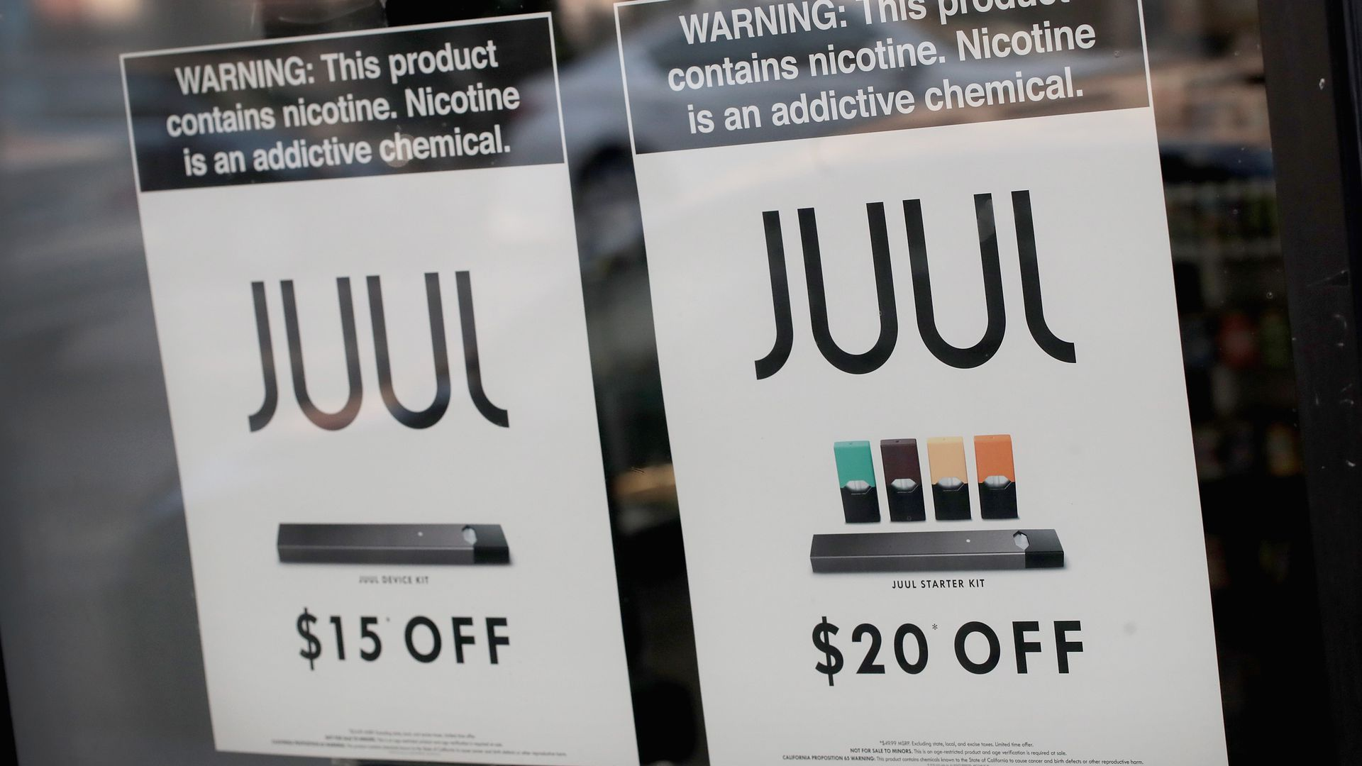 Juul signs at a storefront
