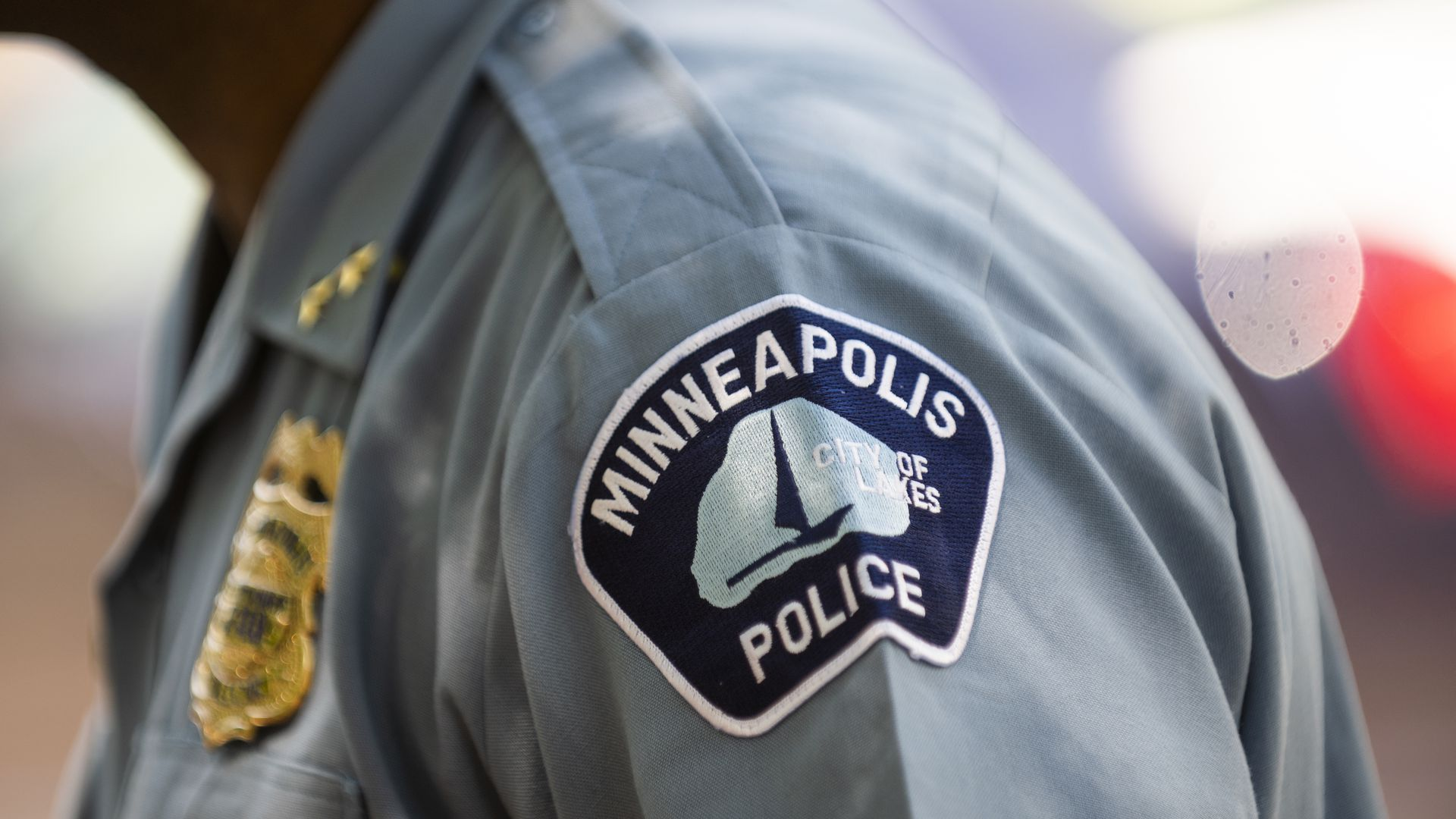 A Minneapolis police officer badge on a uniform.