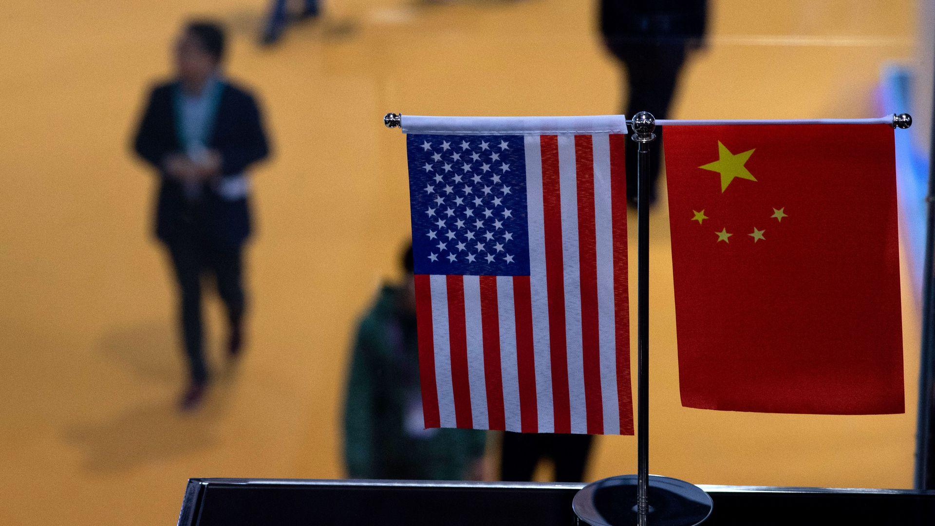 A Chinese and US flag at a booth during the first China International Import Expo (CIIE) in Shanghai.