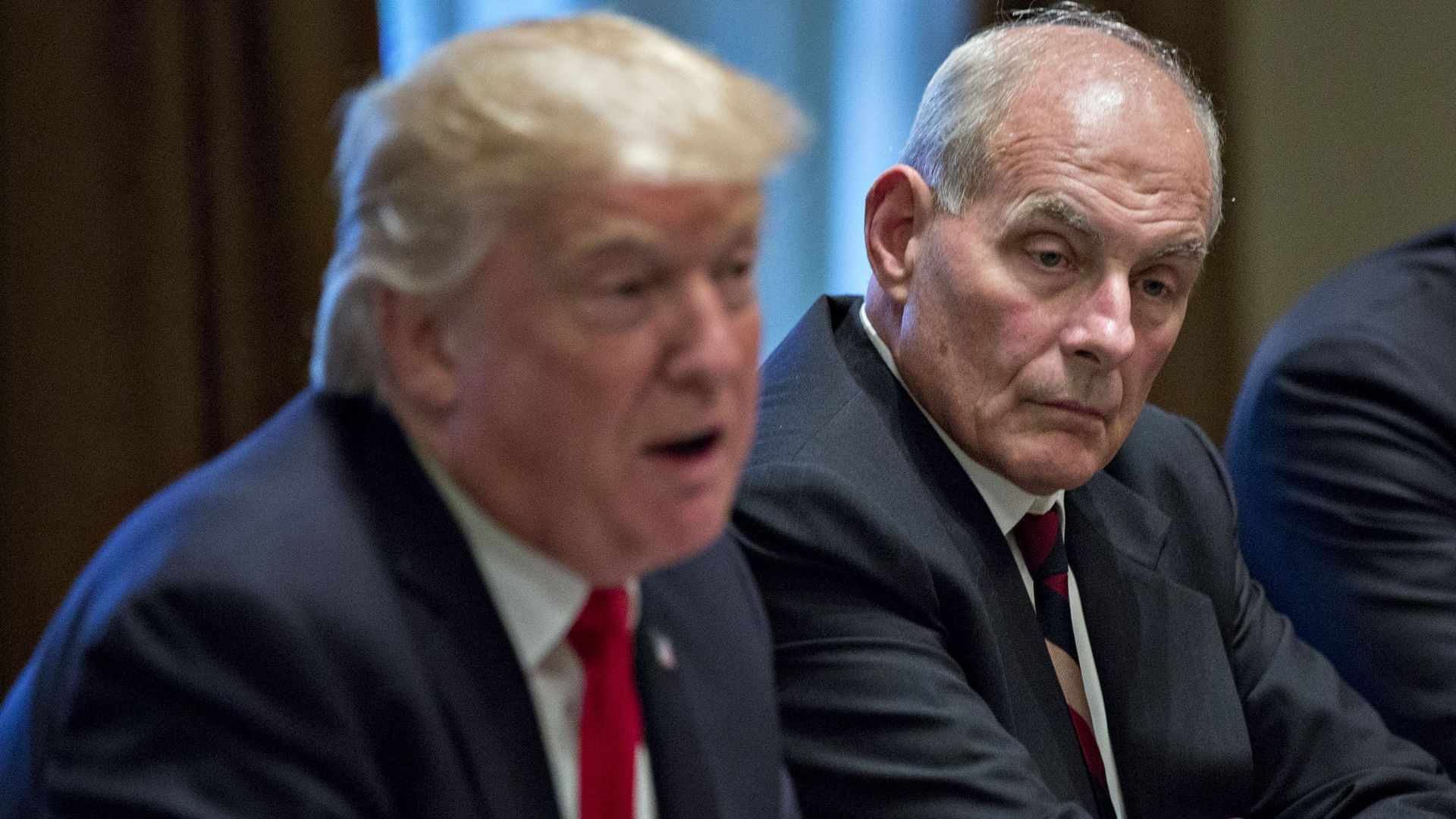 John Kelly looks on while President Trump speaks