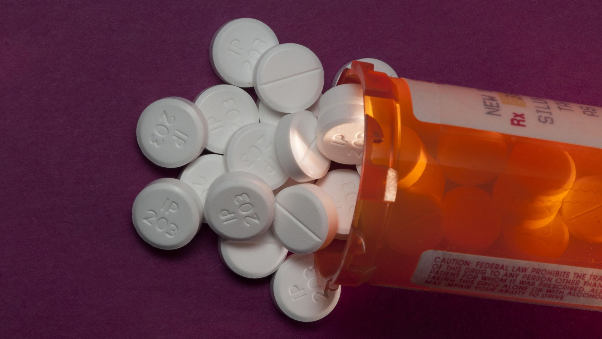 A bottle of oxycodone pills on a table.