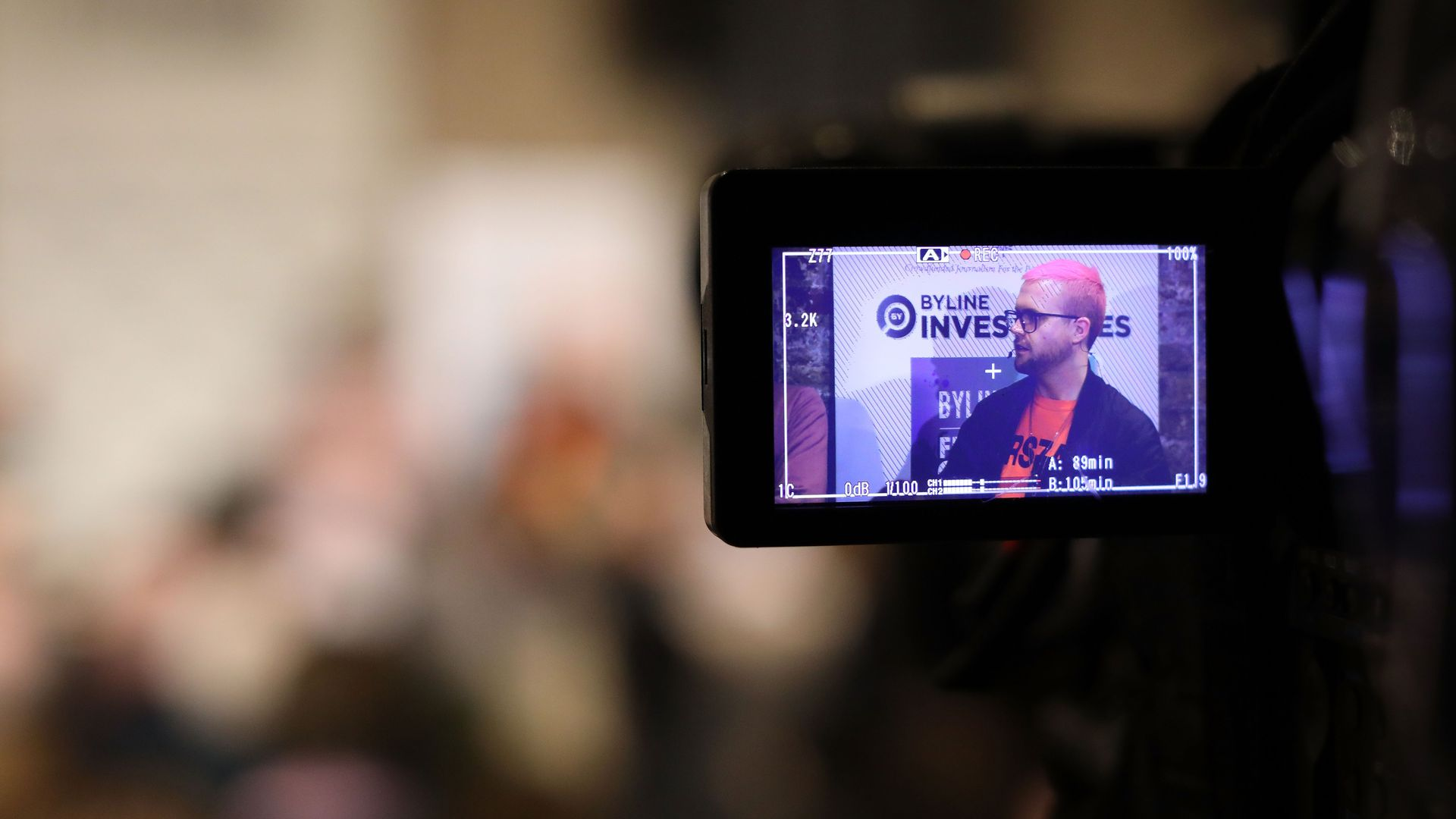 Christopher Wylie is shown on the screen of a video camera