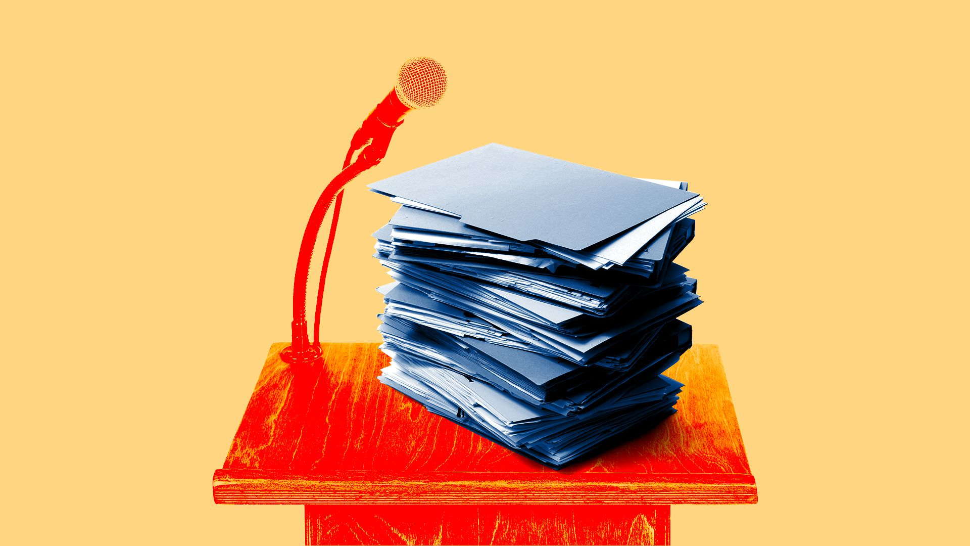 stack of file folders on a lectern with a microphone