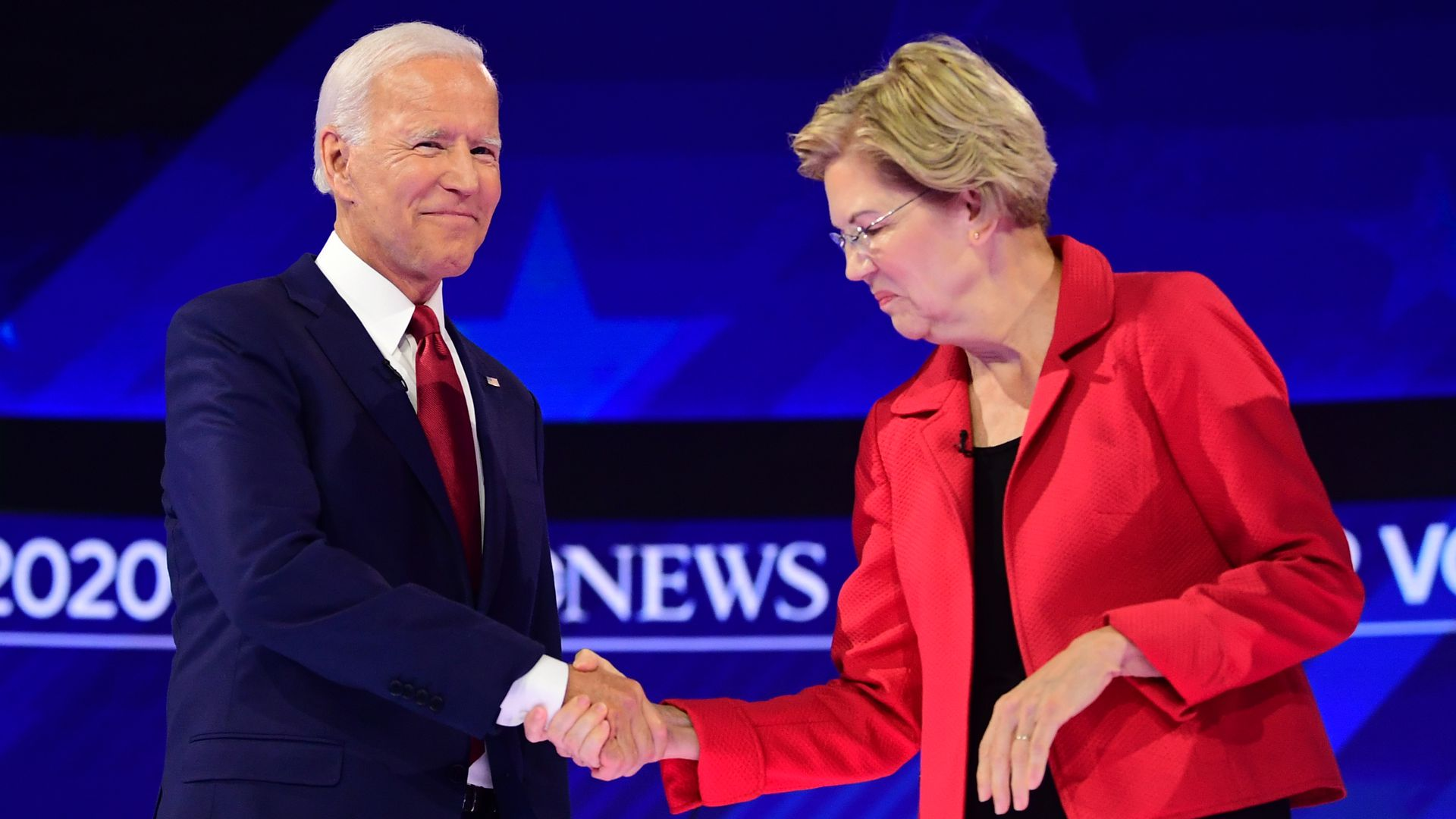 Warren and Biden shaking hands.