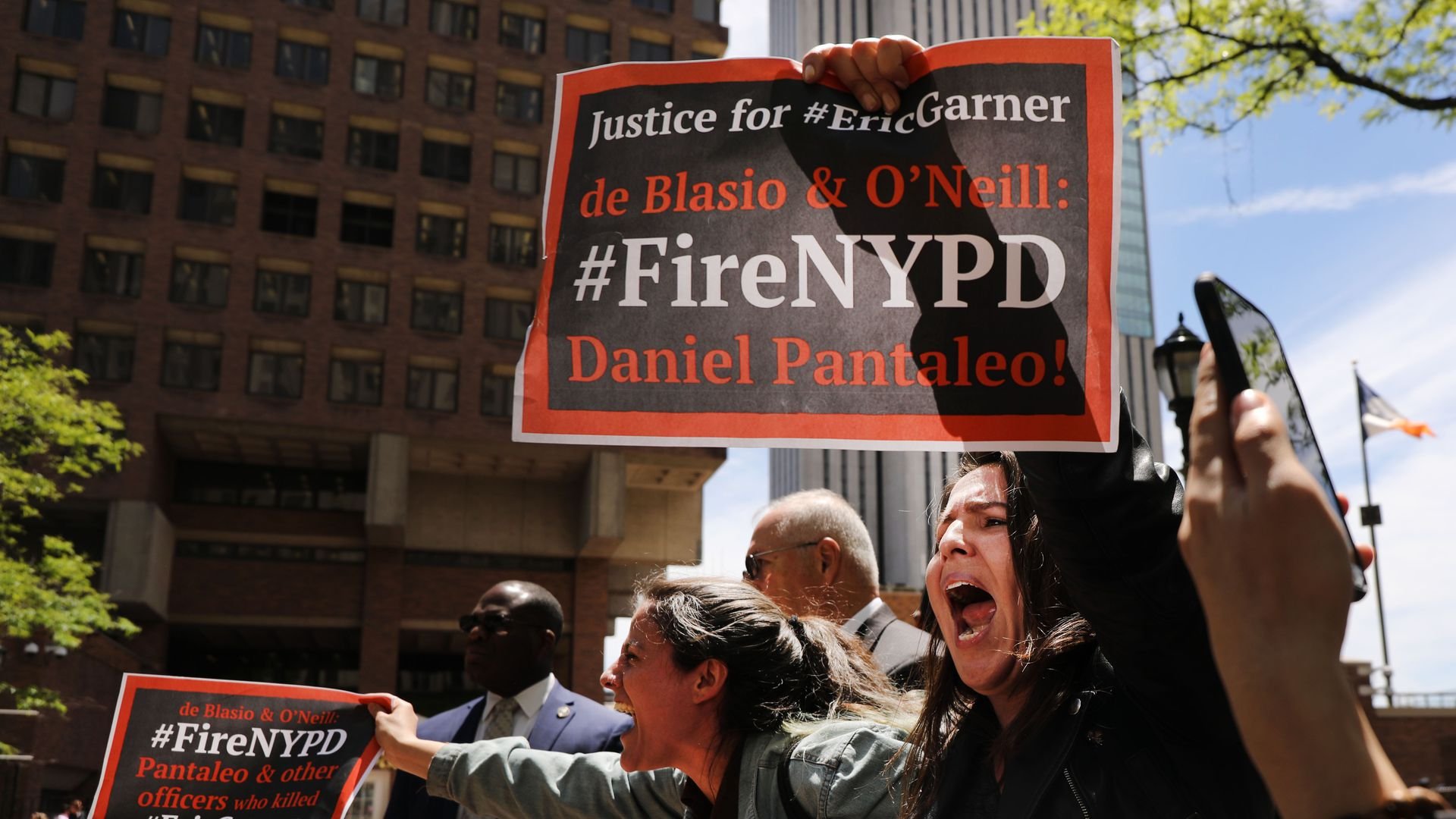 Protesters calling for officer Daniel Pantaleo to be fired following Eric Garner's death