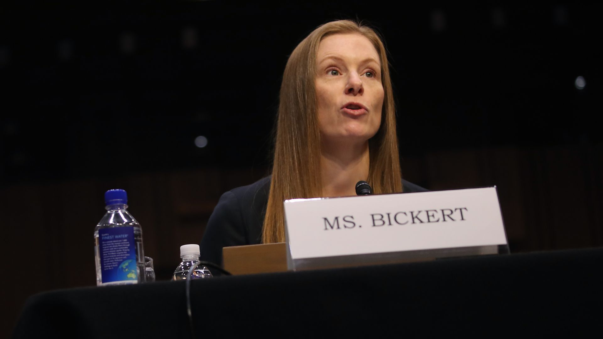 A photo of Facebook's Monika Bickert testifying at a table with a name plate in front of her.