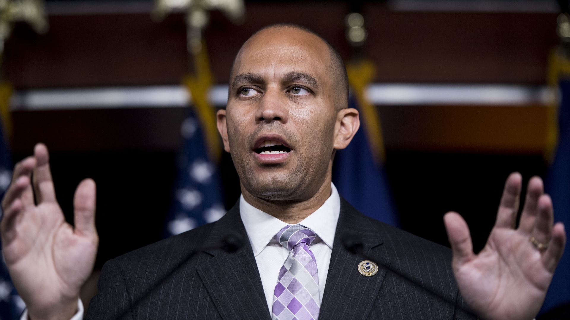 Rep. Hakeem Jeffries with his mouth open and hands up by his sides.