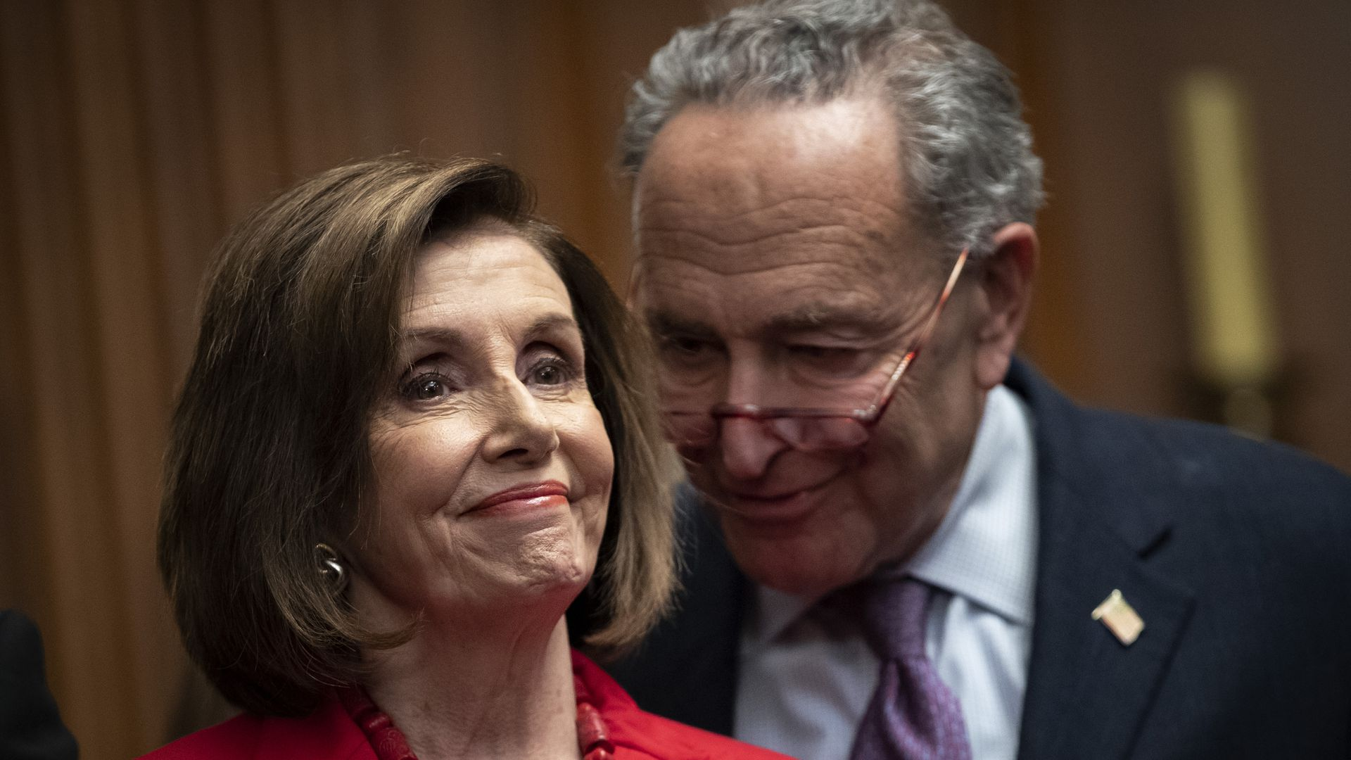 House Speaker Nancy Pelosi and Senate Minority Leader Chuck Schumer stand next to one another at a news conference.