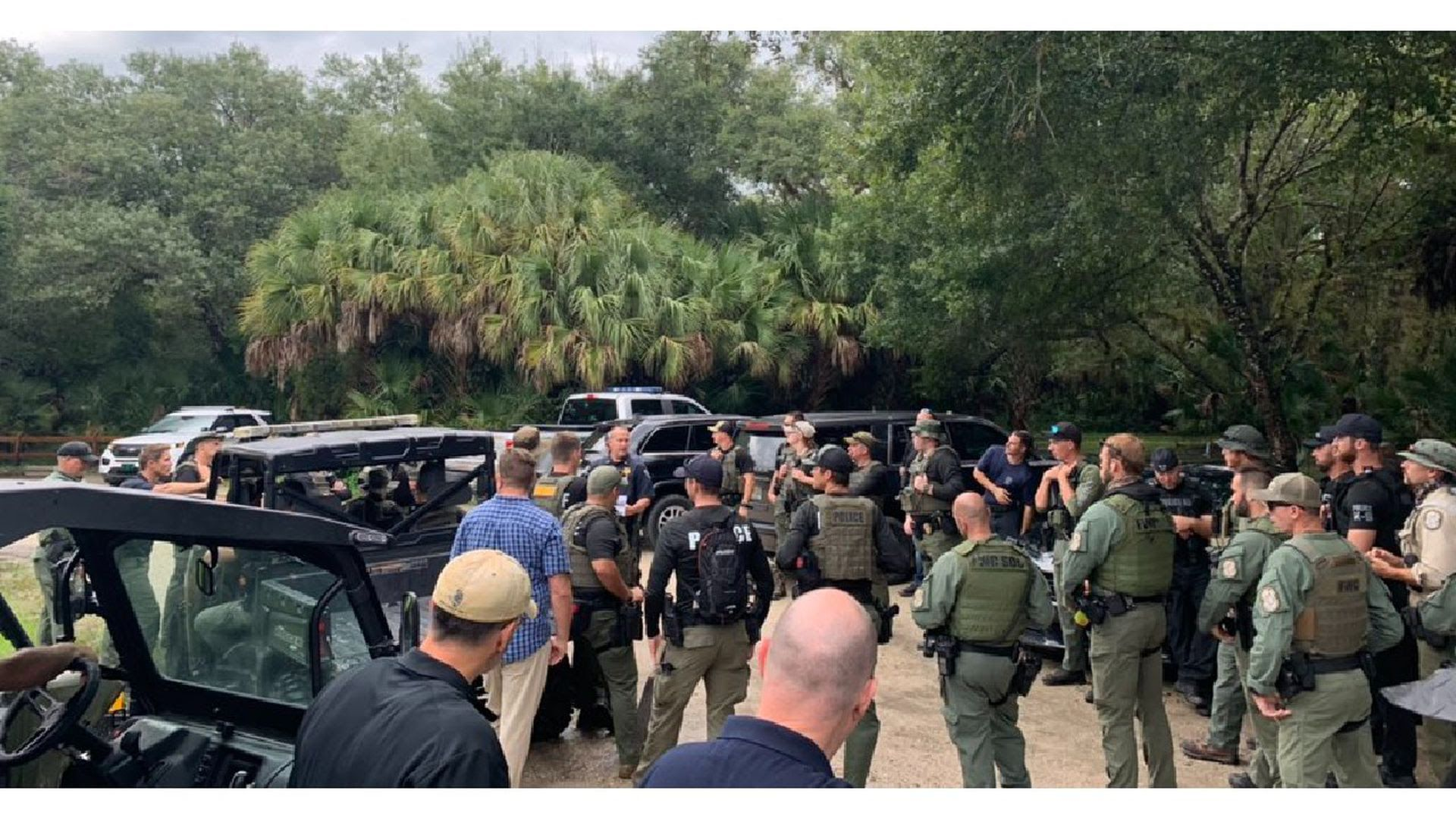 Law enforcement officials gather to search the Carlton Reserve for Brian Laundrie.