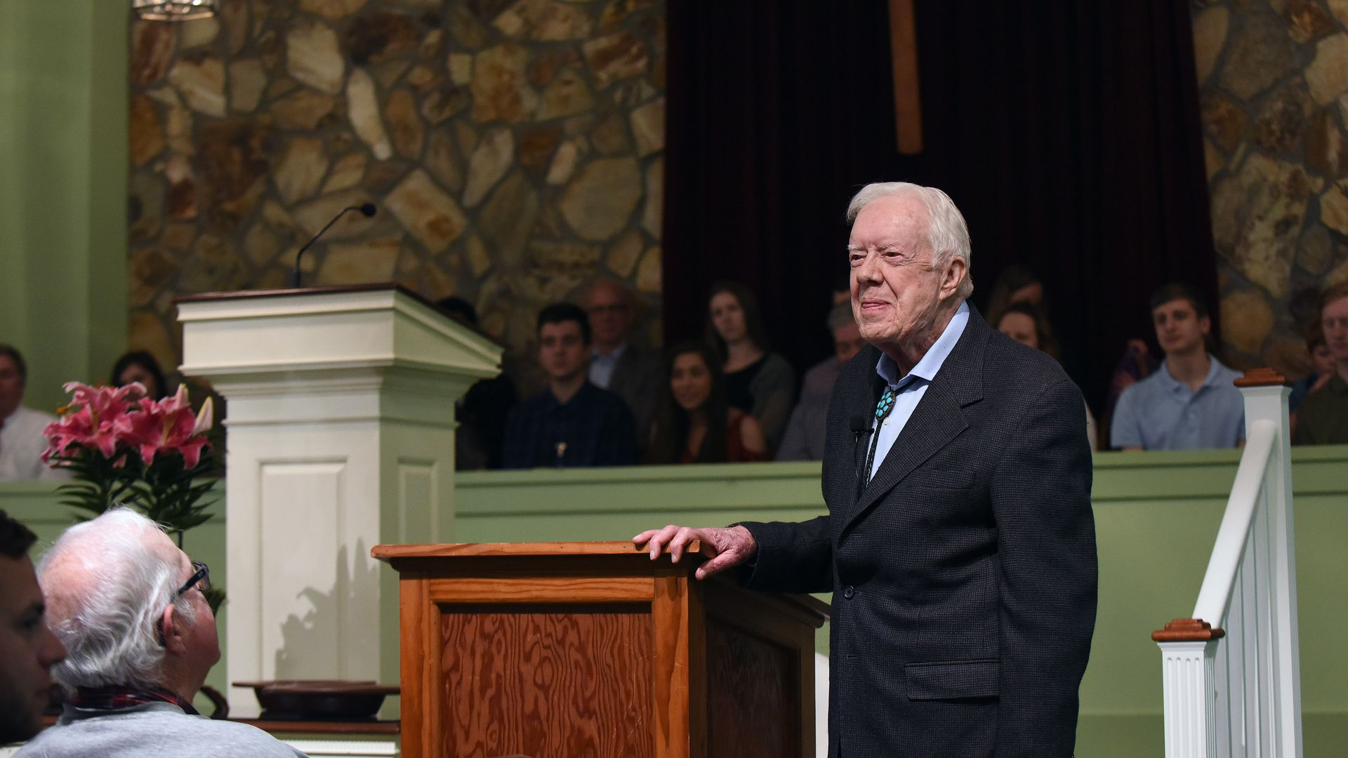 Former U.S. President Jimmy Carter speaks to the congregation at Maranatha Baptist Church before teaching Sunday school in his hometown of Plains, Georgia