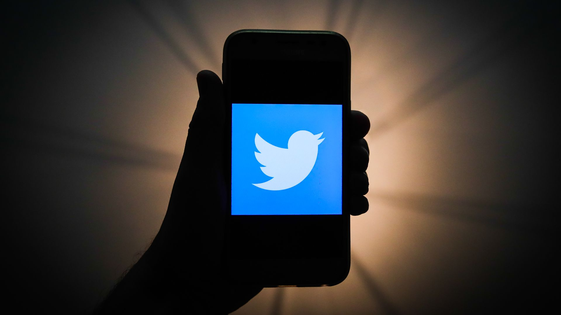 Twitter logo is seen displayed on a phone screen in this illustration photo taken in Krakow, Poland on November 13, 2019.