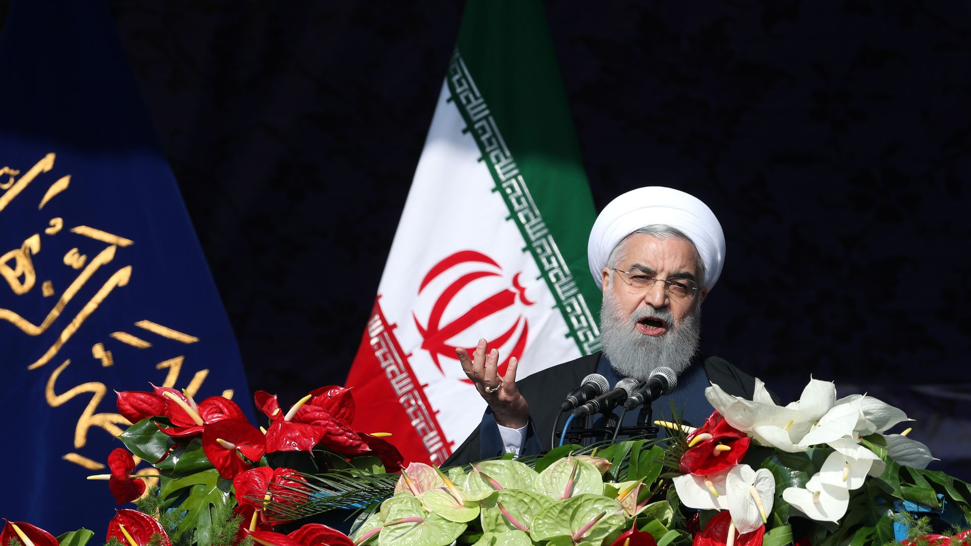 Iranian President Hassan Rouhani delivers a speech during a ceremony to mark the 39th anniversary of the Islamic revolution on February 11, 2018