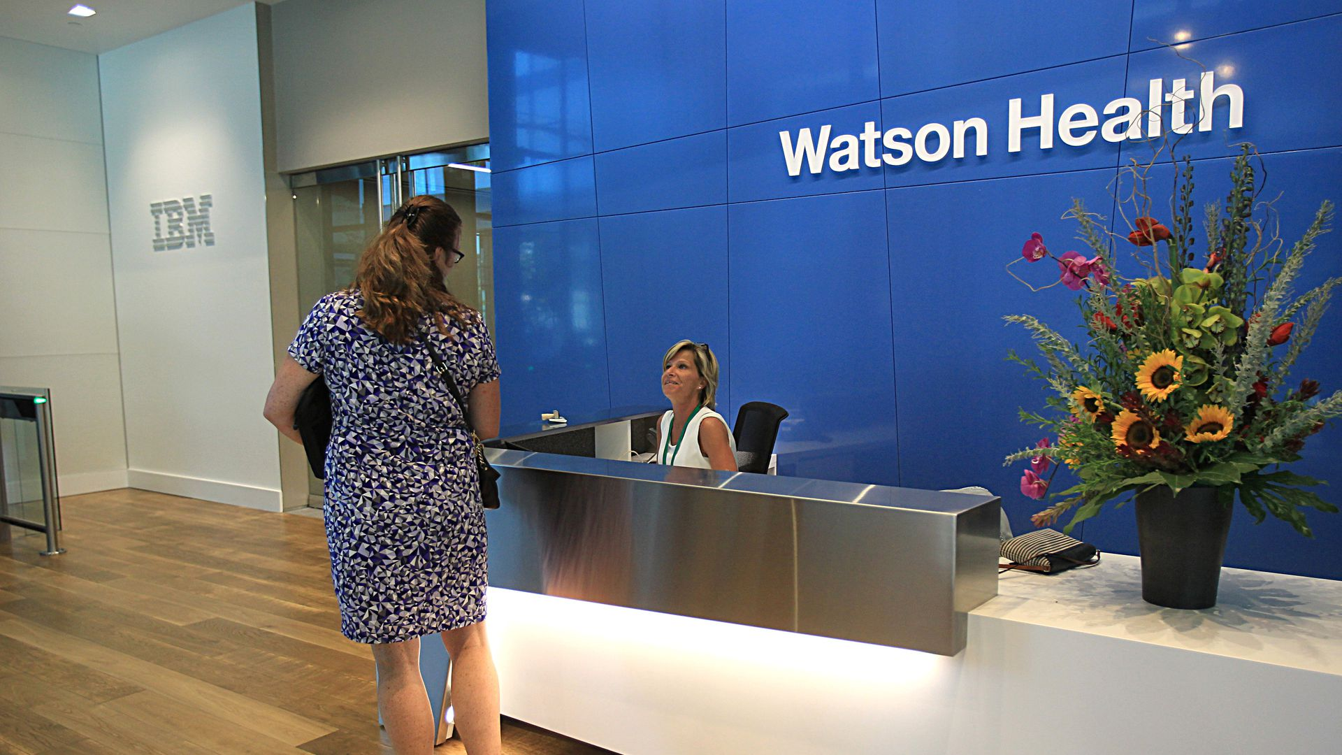 Two women in the lobby of IBM Watson Health headquarters in Massachusetts.