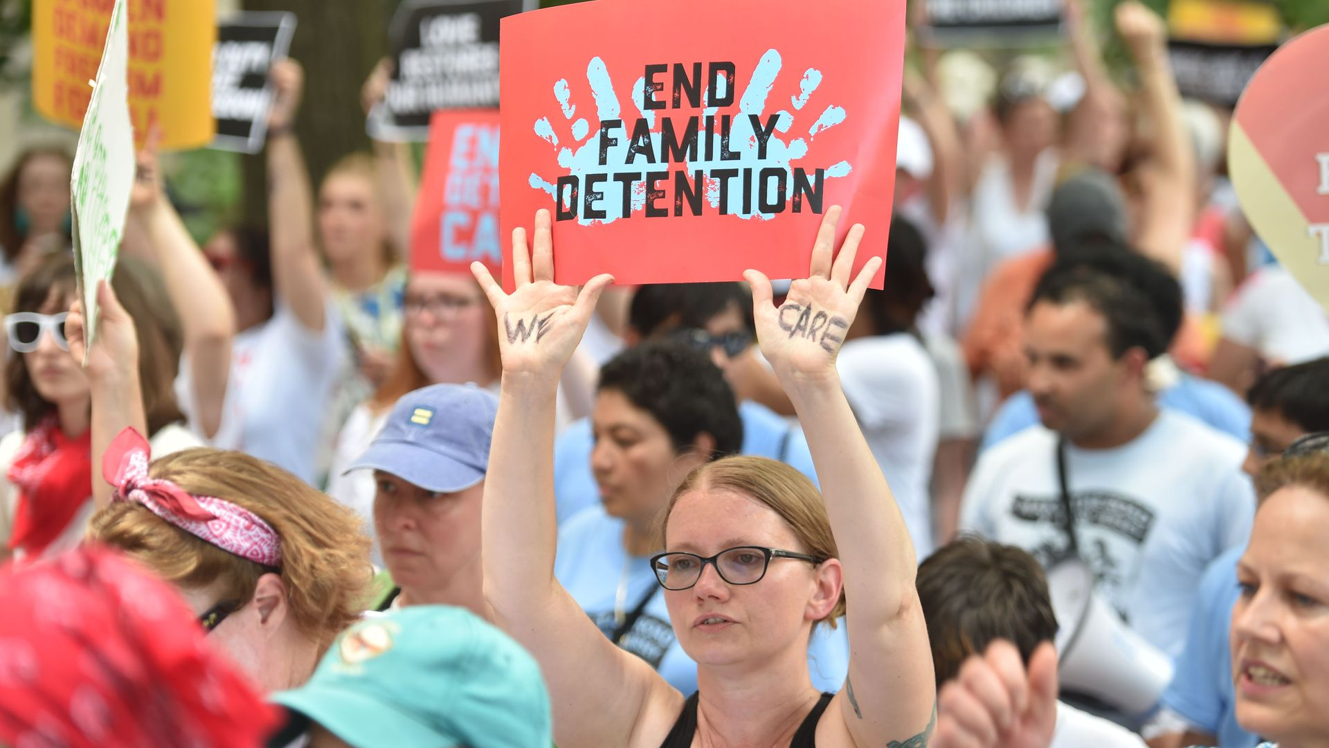 A crowd protests against family separation policies.