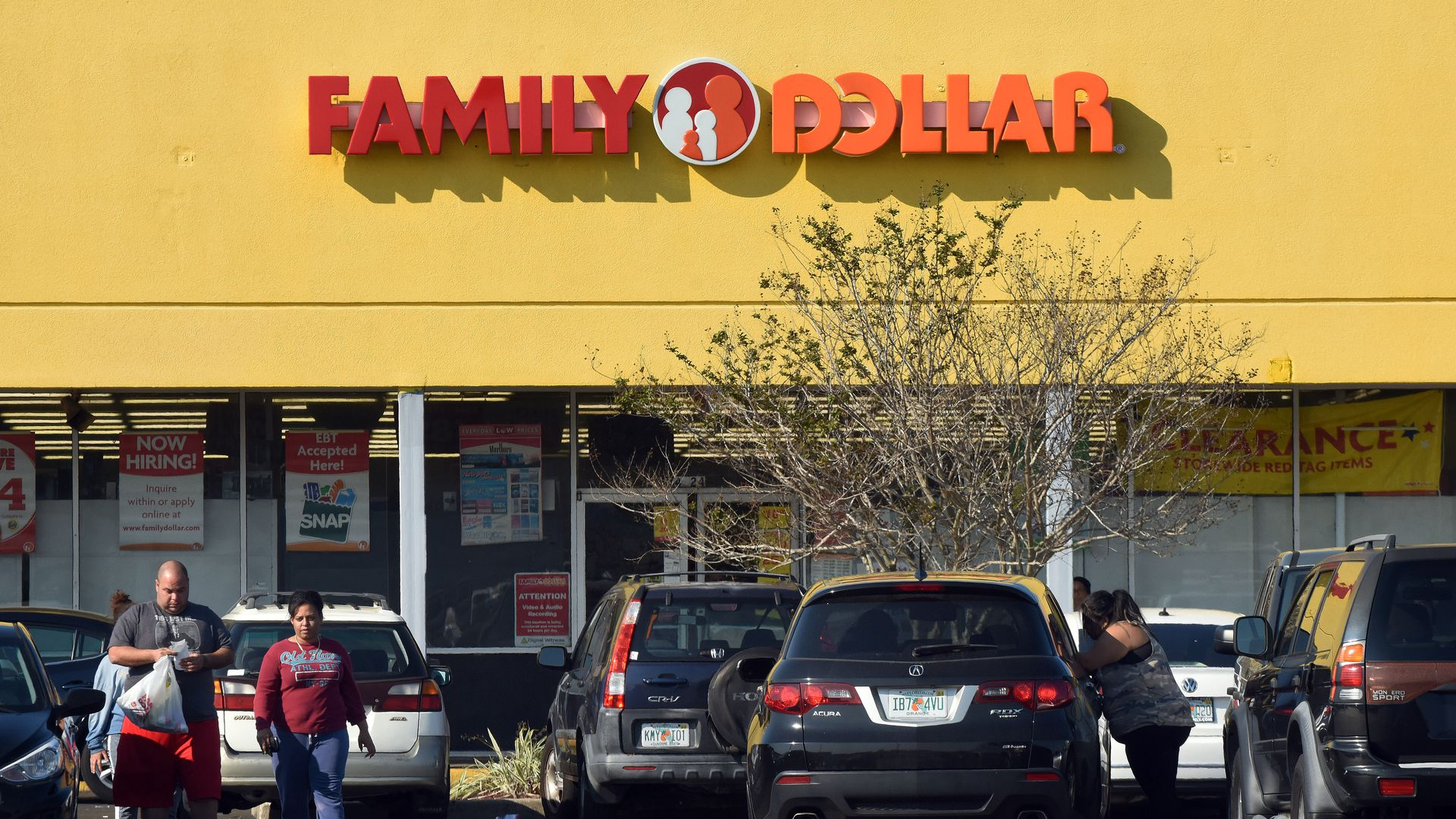 In this image, shoppers walk through the parking lot away from a Family Dollar store.