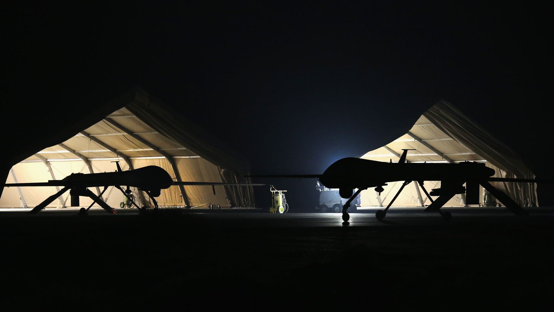 U.S. Air Force Predator drones at base at night
