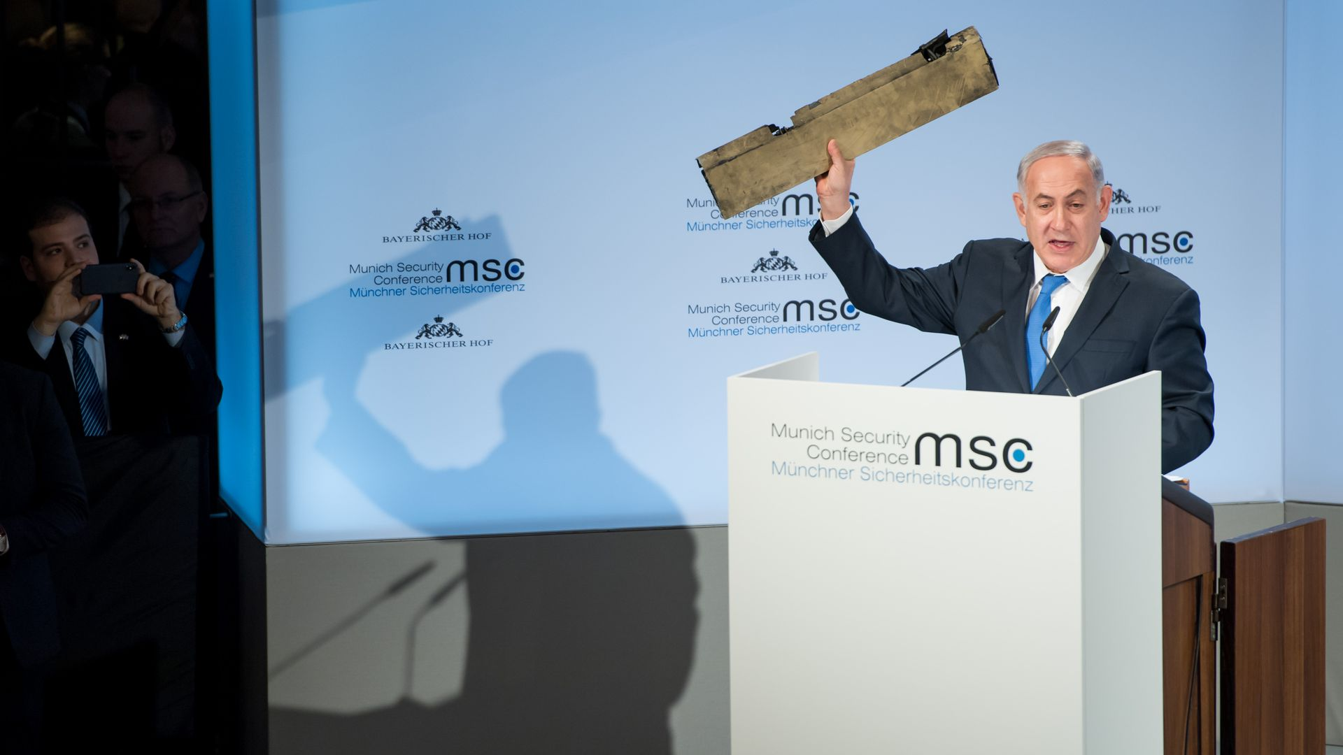 Israeli Prime Minister Benjamin Netanyahu holds up what he claims is a piece of an Iranian drone.