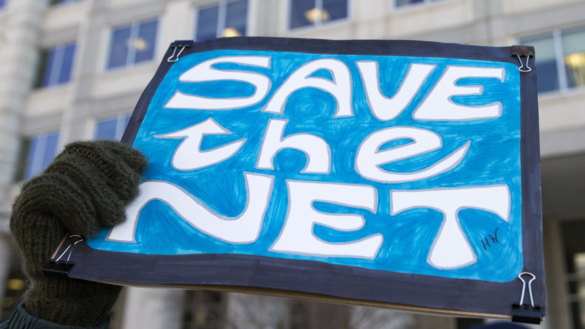 "Protest sign reading ""Save the Net"""
