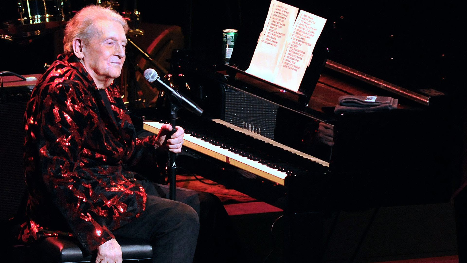 Jerry Lee Lewis sits in front of a piano at the Van Wezel Performing Arts Hall in Sarasota.
