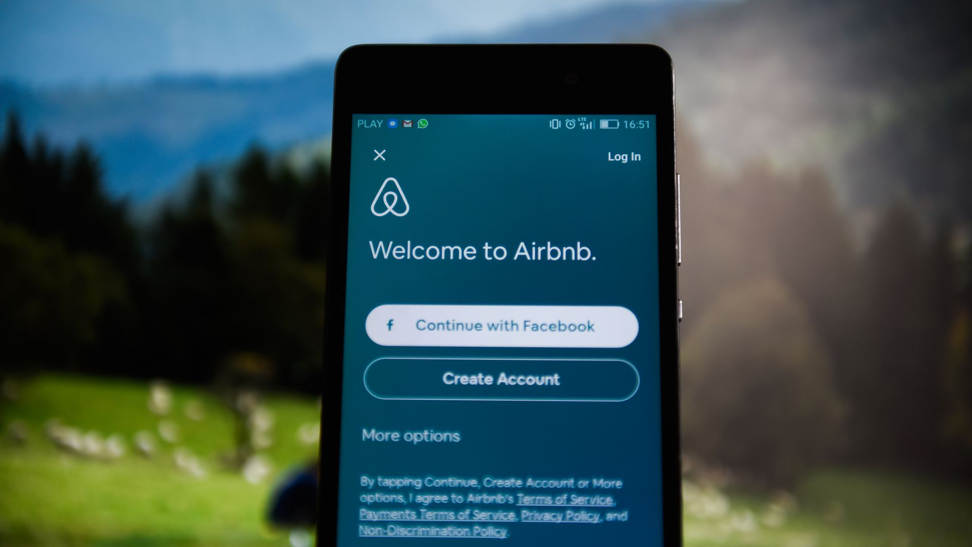 A phone with the airbnb app opened.