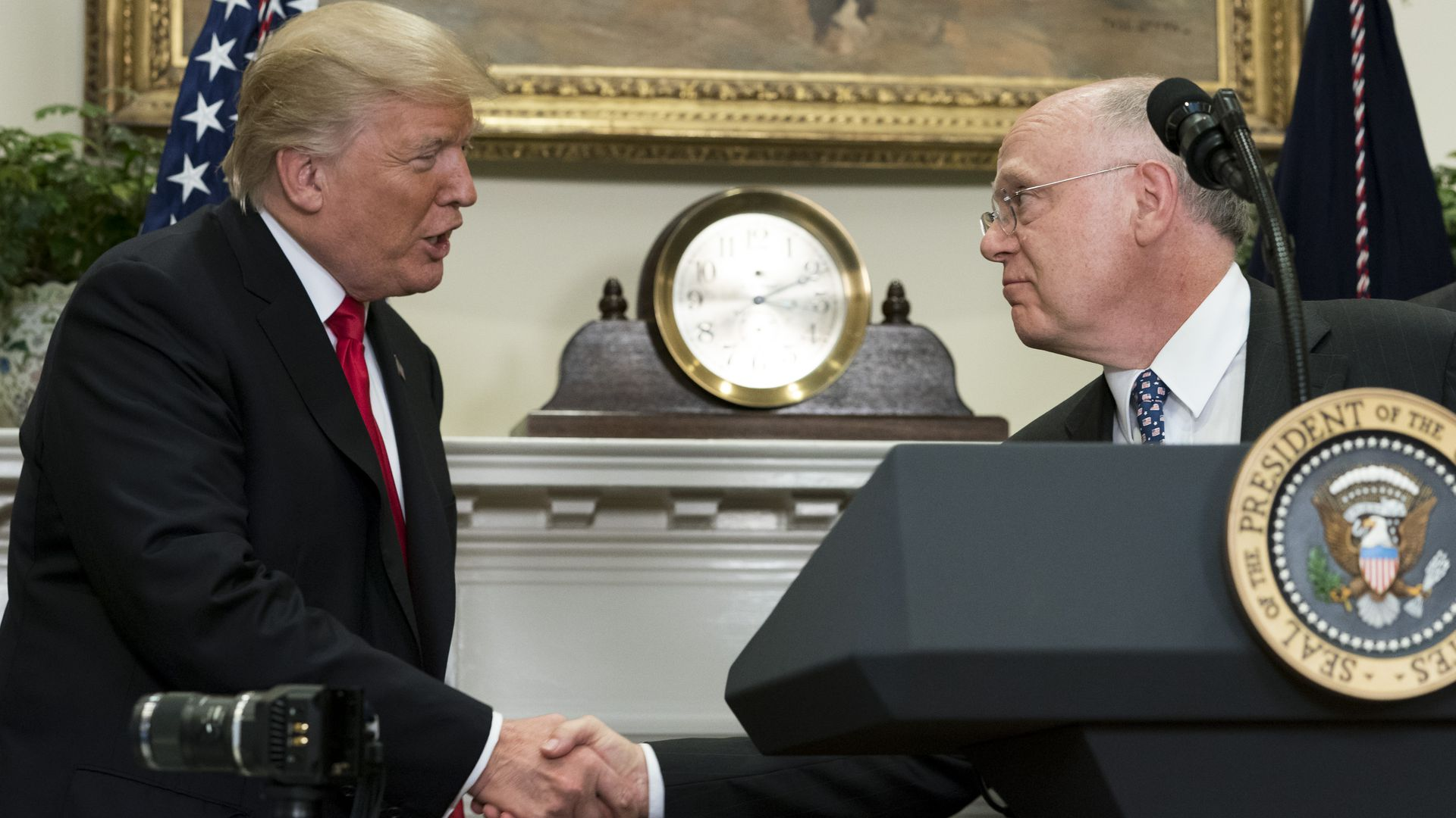 President Trump shaking hands with Ian Read, CEO of Pfizer.
