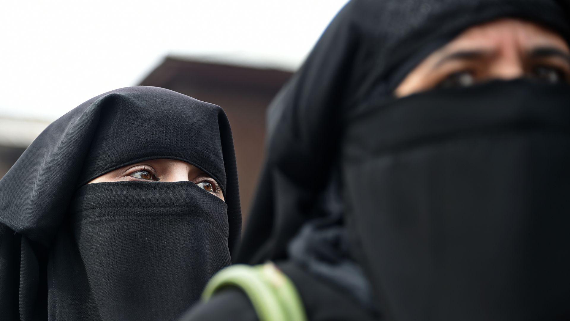 Women in traditional Muslim dress.