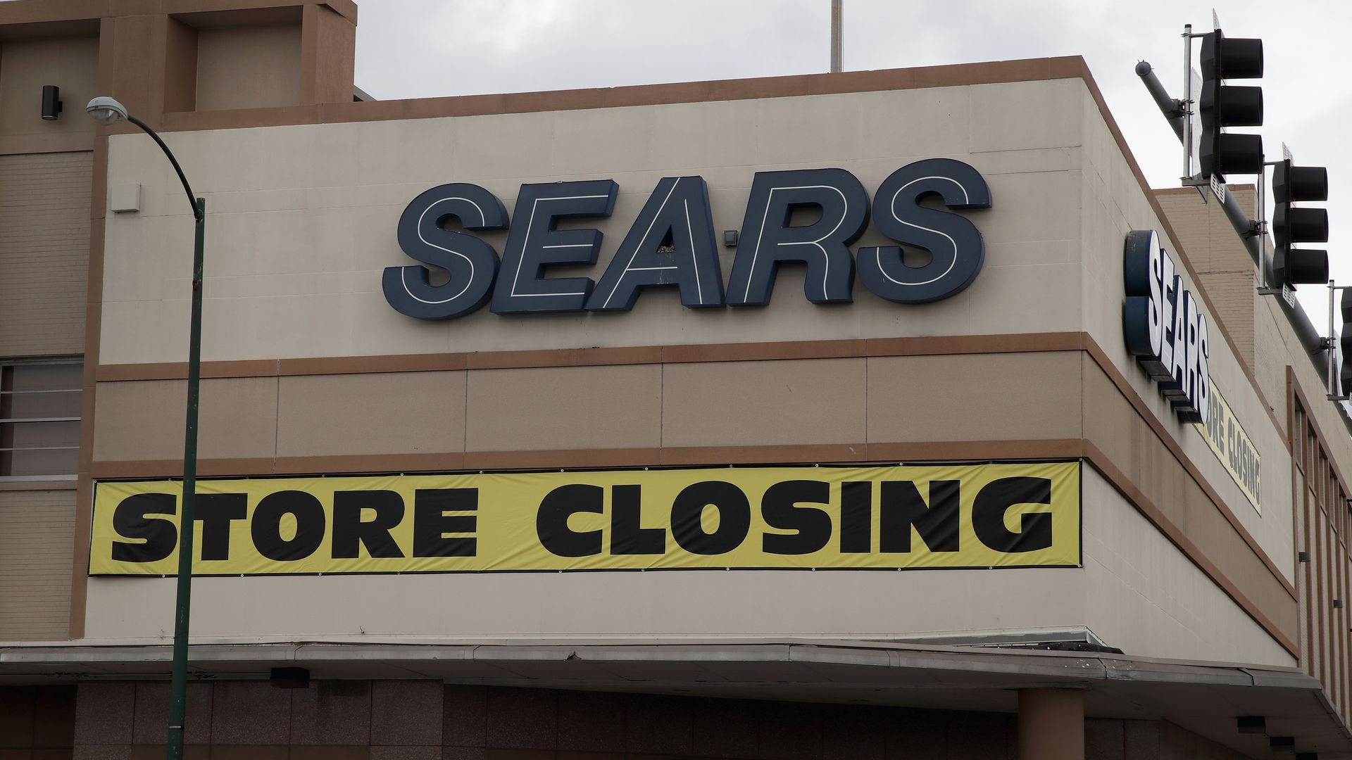 Sears store with a closing sign on it