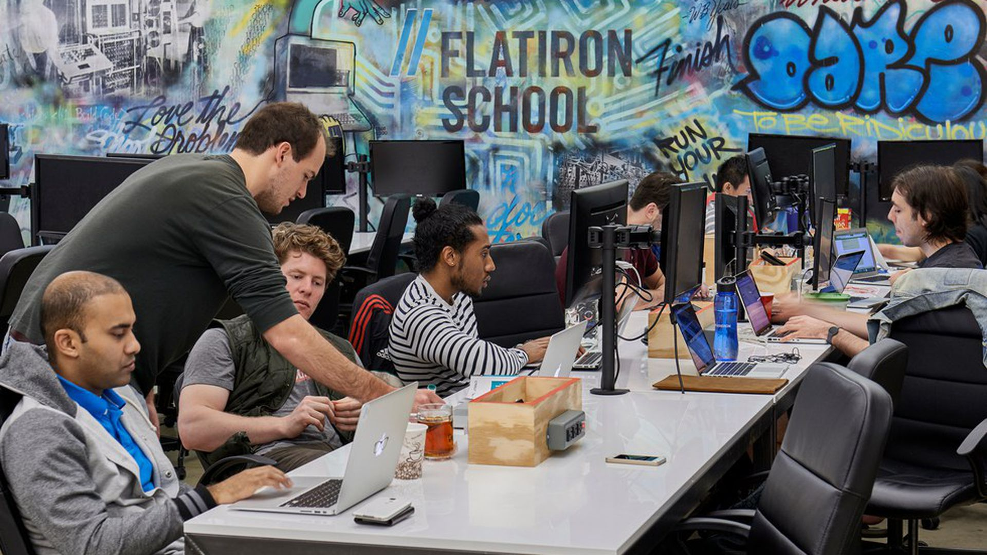In a bet against college, WeWork acquires a coding bootcamp