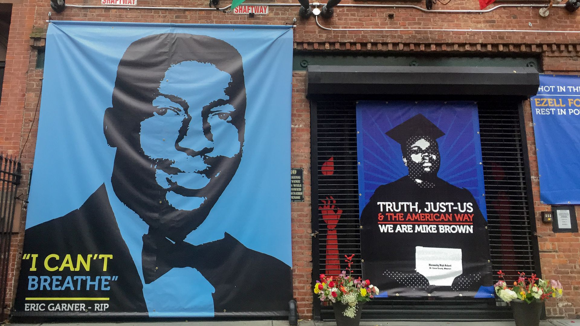 Posters of Eric Garner and Mike Brown who died after interactions with officers