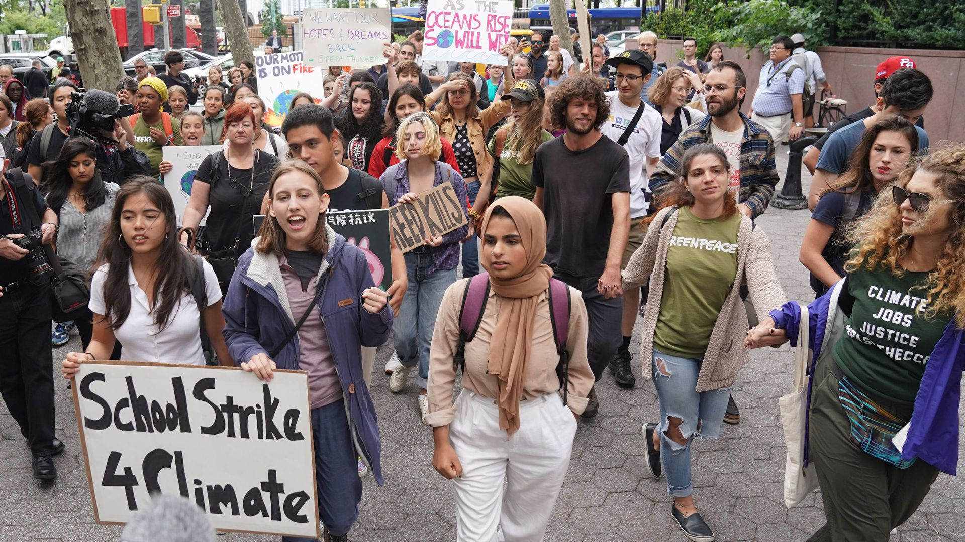 Students march outside the United Nations during a protest against climate change on September 6, 2019 in New York.