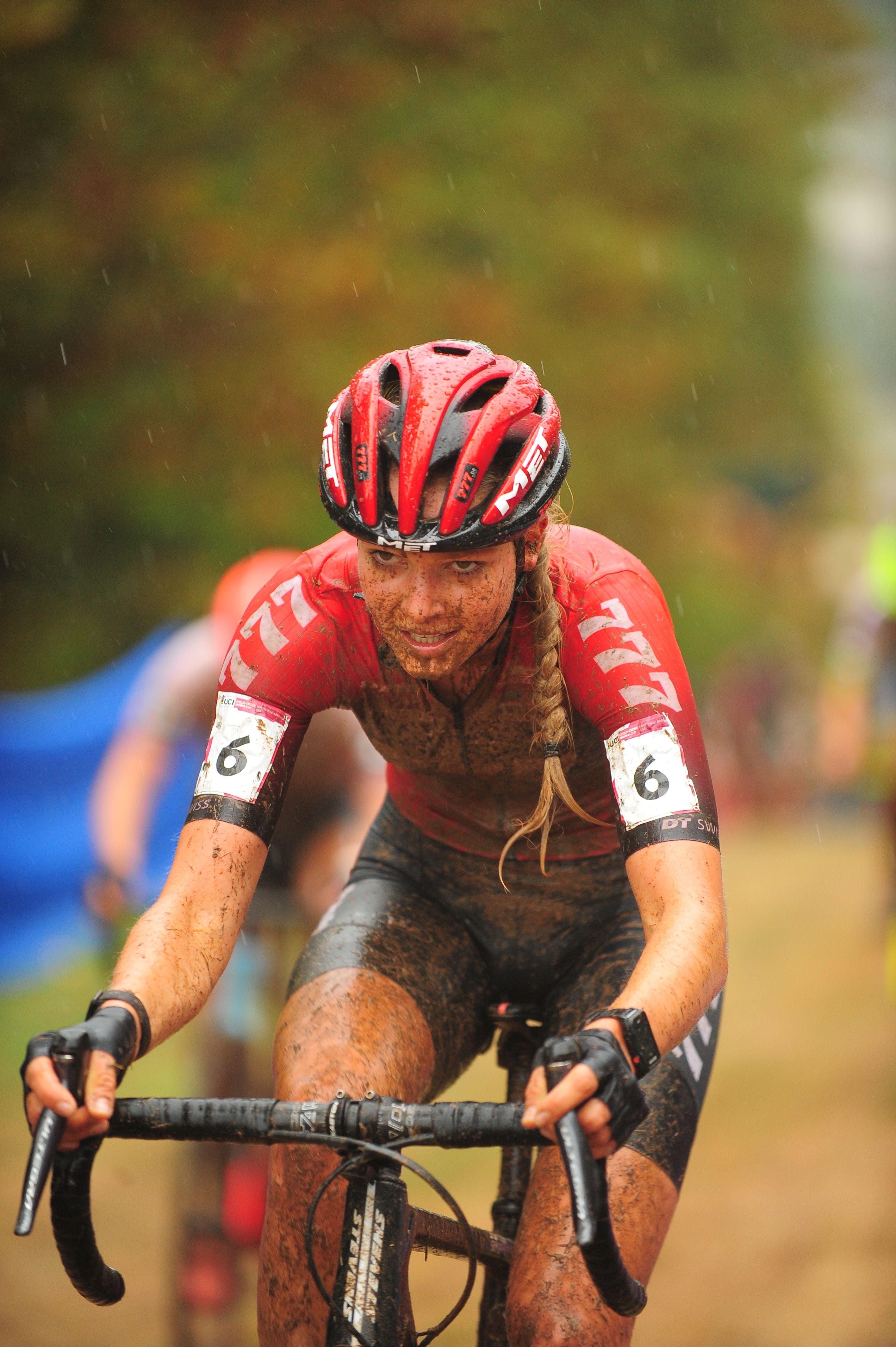 Photo of a muddy woman riding a bike.
